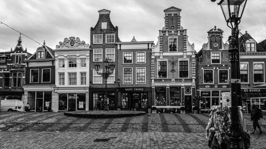Alkmaar, Netherlands-August 15th 2017: Commercial buildings in the old town Architecture Nerherlands bBuilt StructurecCityHHolidayCCityscapeuUnknown PeopletTraditionaltTourismsStreetSSquareSShopsoOldmMarketplacelLandmarkhHousehHistoricalFFamouseEuropeCCityBBusiness HousesbBuildingaAlkmaar dDutchNNorth Holland
