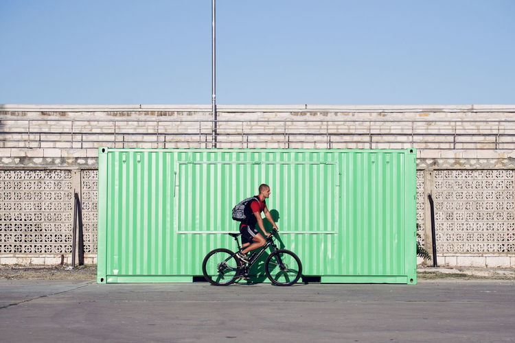 Symmetry Minimalism Deceptively Simple Bycicle Rider Pastel Power Eyeemphoto Geometry The Color Of Sport People And Places TakeoverContrast Enjoy The New Normal Embrace Urban Life Colour Your Horizn #urbanana: The Urban Playground