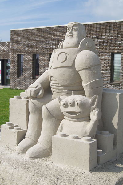Built Structure Buzzlightyear Day No People Outdoors Pixar  Sand Sandsculpture Sculpture Sky Space Statue Sunlight Toy Story