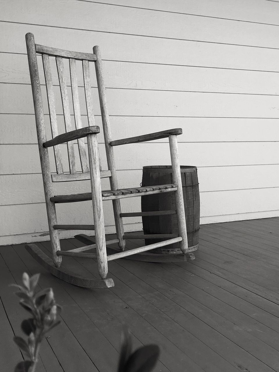 Chair On Porch Against Wall