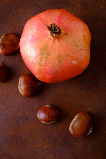 Autumn Fruits, Pomegranate and Chestnuts Chestnuts Close-up Food Food And Drink Four Objects Freshness Fruit Group Of Objects Healthy Eating High Angle View Indoors  Medium Group Of Objects No People Nut Nut - Food Pomegranate Raw Food Red Still Life Table Wellbeing