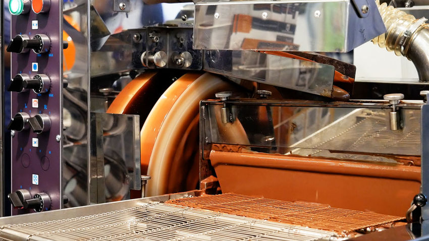 Chocolate Conveyor Belt Close-up Conveyer Conveyor  Day Factory Hot Chocolate Indoors  Industry Machinery Manufacturing Equipment Milk Chocolate No People Production Line Technology Business Stories
