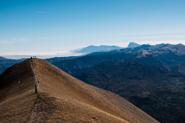 Scenic view of mountain range against sky in arquata del tronto, marche italy