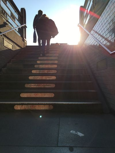 Low angle view of woman walking on steps