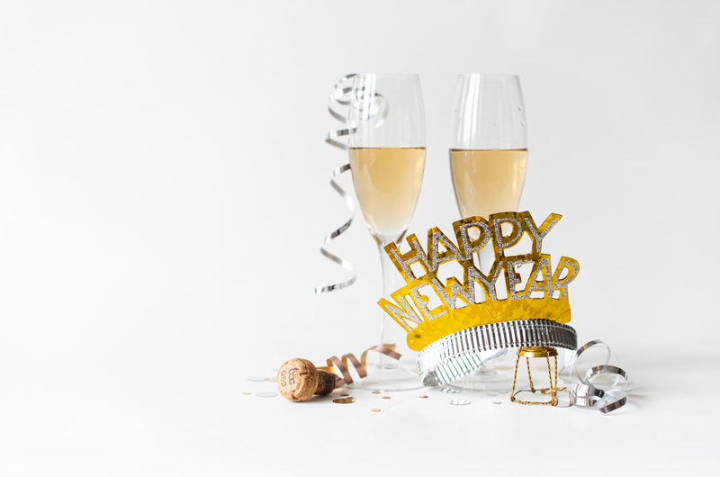 Close-up of beer glass on table against white background