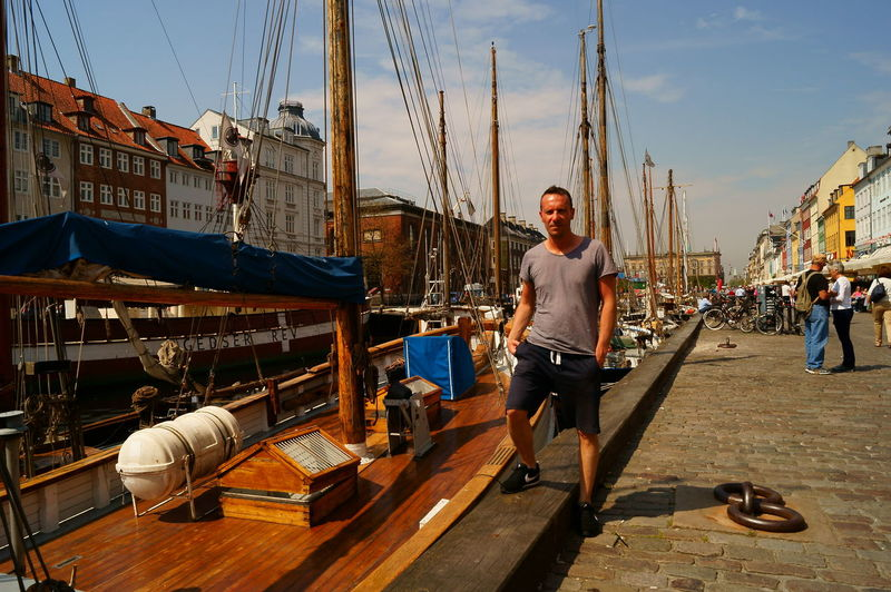 Architecture Nautical Vessel Full Length Portrait Looking At Camera Building Exterior Transportation Real People One Person Mode Of Transportation Sky Built Structure Water Casual Clothing Nature Mast Day Front View City Harbor Sailboat