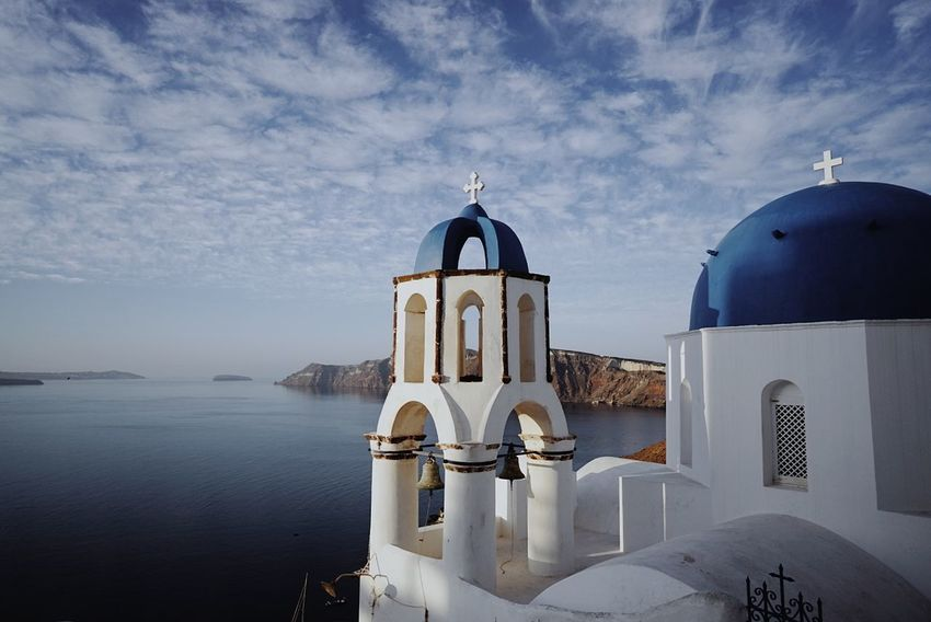 Sea Travel Destinations Architecture Built Structure Streetphotography First Eyeem Photo Spirituality Architectural Column Low Angle View Cross Clear Sky Vacations Religion Place Of Worship Santorini, Greece Urban Skyline Outdoors