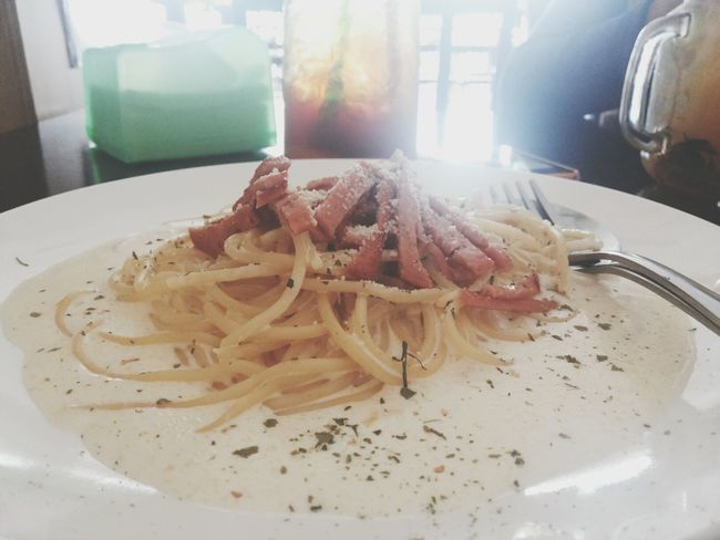 No need to fly far to have the best food.. Carbonara Lunch Meal Indoors  Food And Drink Plate Food Close-up Day Starving Western Food Spaghetti Carbonara Italian Food Foodstagram Studio Shot The Secret Spaces Bokeh Ready-to-eat Hungry Carbohydrates Diet