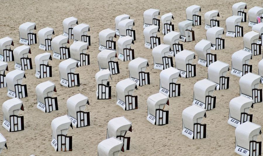 Large Group Of Objects White Color No People In A Row Built Structure Repetition Abundance Side By Side Outdoors Backgrounds Pattern Beach Life Beach Chairs