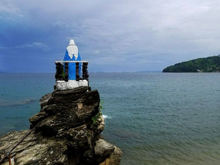 Statue of the Virgin Mary over looking the bay at Virgin Beach Mindoro Philippines Beach Sea Horizon Over Water Summer Leisure Activity Philippinesphotography Tranquility Vacations Scenics Beauty In Nature Southeastasia EyeEm Best Shots Travel Philippines Photos Tourism Travel Destinations Travelphotography Travel Photography EyeEmBestPics