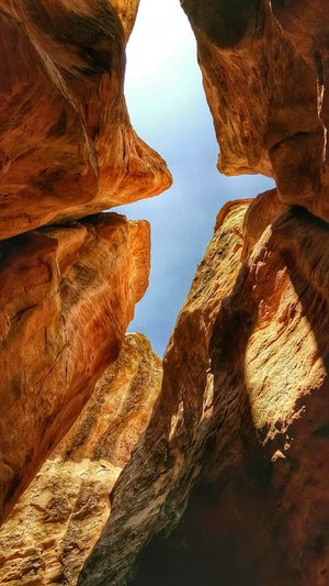 Low angle view of rocks with sky in background