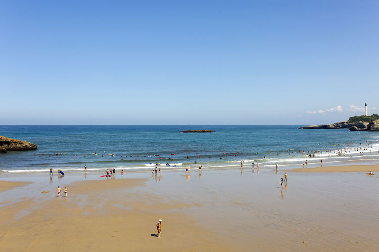 Scenic view of beach against clear sky