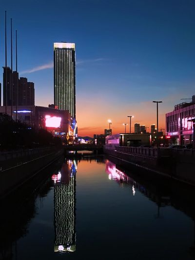 Reflection Illuminated Architecture City Sky Built Structure Building Exterior Night Water Waterfront River Modern Futuristic Outdoors No People Bridge - Man Made Structure Skyscraper Adapted To The City Adapted To The City The City Light