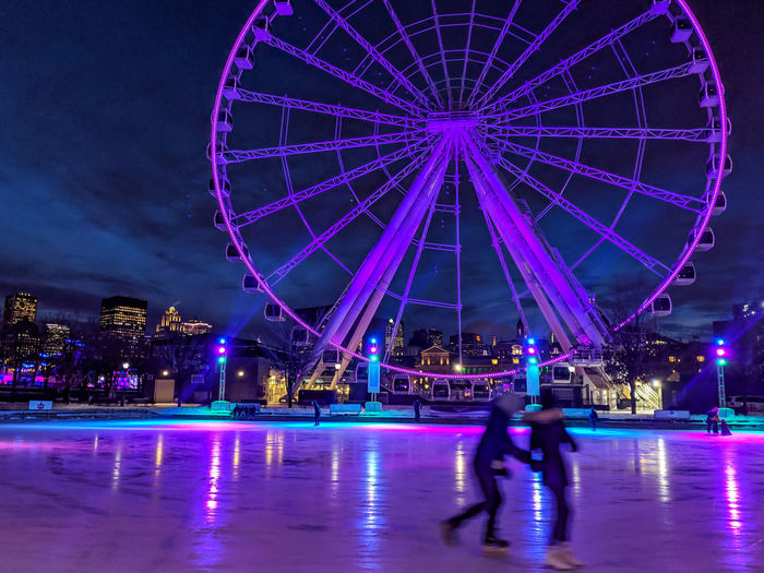 Amusement Park Amusement Park Ride Arts Culture And Entertainment Illuminated Night Architecture Leisure Activity Motion Ferris Wheel Built Structure Sky Enjoyment Winter Sport Group Of People Fun Travel Destinations City Nature Blurred Motion Ice Outdoors Purple Nightlife Skating Montreal, Canada