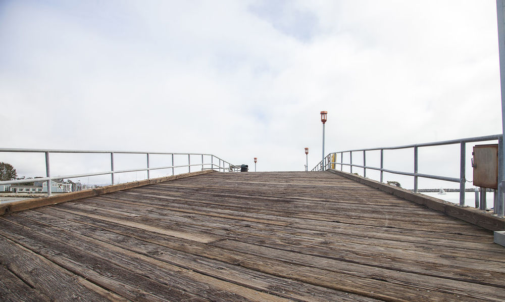 Small wooden pier in Dana Point Harbor in Southern California, USA Backgrounds Boardwalk Boardwalks Bridge - Man Made Structure Dana Point, Ca Day No People Ocean Outdoors Pier Railing Sea Sky USA Water Wood Wood - Material