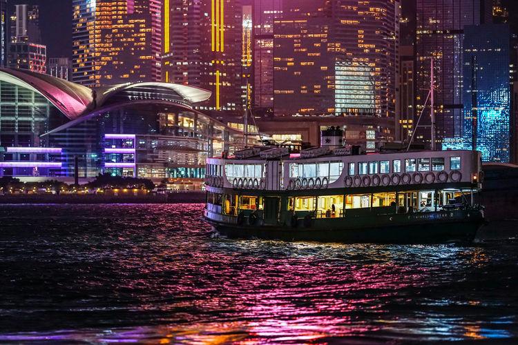 Illuminated buildings at waterfront