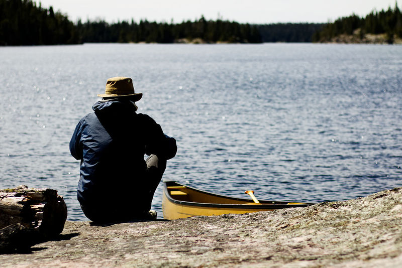 solo canoeing in northern Ontario, Canada Canoe Canoeing Nature Solo Traveler! Beauty In Nature Lake Lake View Lakeside Lifestyles Men Nature Nautical Vessel Outdoors Paddleboarding Paddling People Real People Rear View Solo Solotraveler Tree Water Yellow