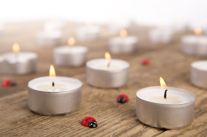 Aromatherapy Aromatherapy Oil Burning Candle Candlelight Decoration Flame Focus On Foreground Group Of Objects Health Spa Healthy Lifestyle Indoors  Lifestyles Luxury No People Relaxation Scented Spa Treatment Still Life Tea Light Tranquil Scene Vibrant Color Wellbeing Wood - Material Zen-like