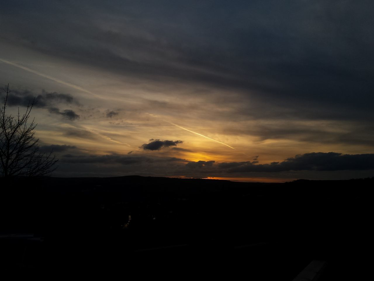 SILHOUETTE OF LANDSCAPE AGAINST SKY