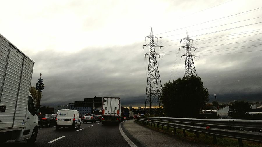 Transportation Electricity Pylon Land Vehicle Mode Of Transport Car On The Move Sky Built Structure Development Tall - High Power Line  Cloud Cloud - Sky Day Outdoors My Daily Commute