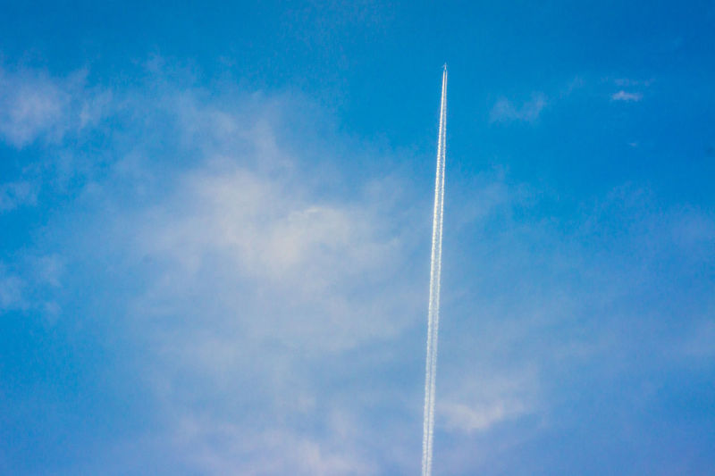 Nowhere Beauty In Nature Blue Contrail Low Angle View Nature No People Plane Sky Vapor Trail