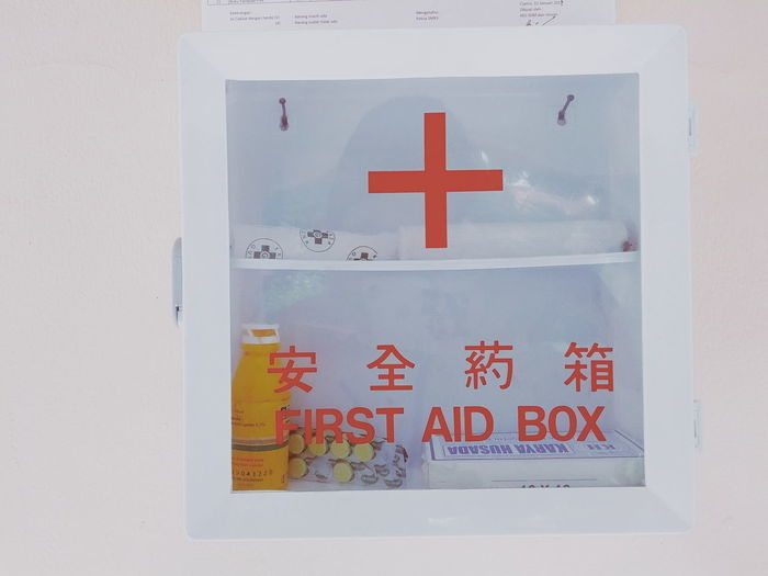 Close-up of warning sign on white box