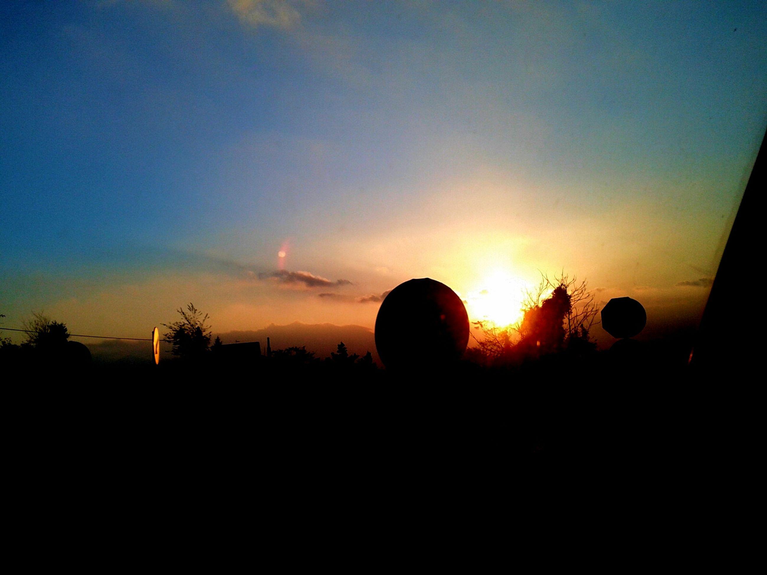 sunset, silhouette, sky, scenics, orange color, beauty in nature, tranquil scene, tranquility, landscape, nature, copy space, dark, sun, idyllic, outdoors, cloud - sky, cloud, moody sky, field, no people