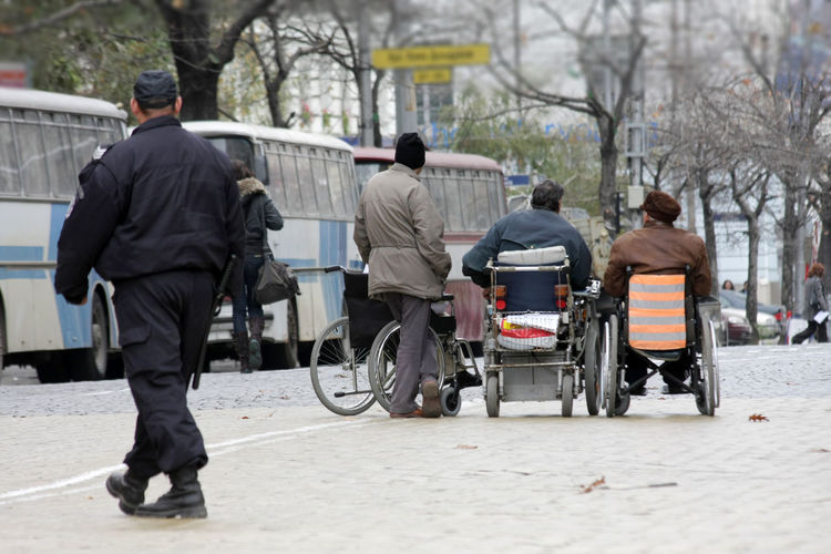 Rear view of people working in city