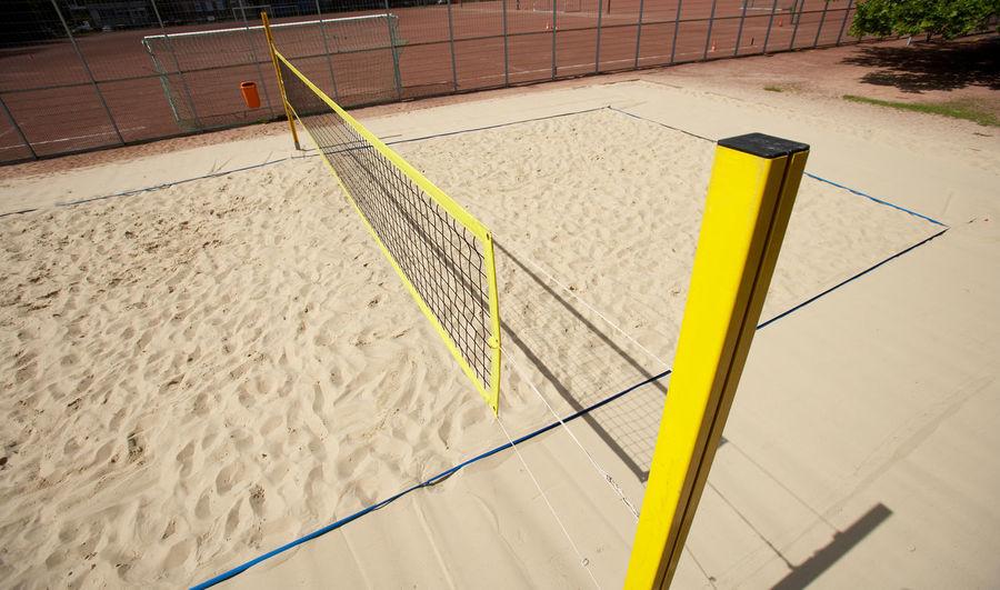 Beachvolleyball Backgrounds Beachvolleyball Field Day High Angle View Net No People Outdoors Sand Summersports Yellow