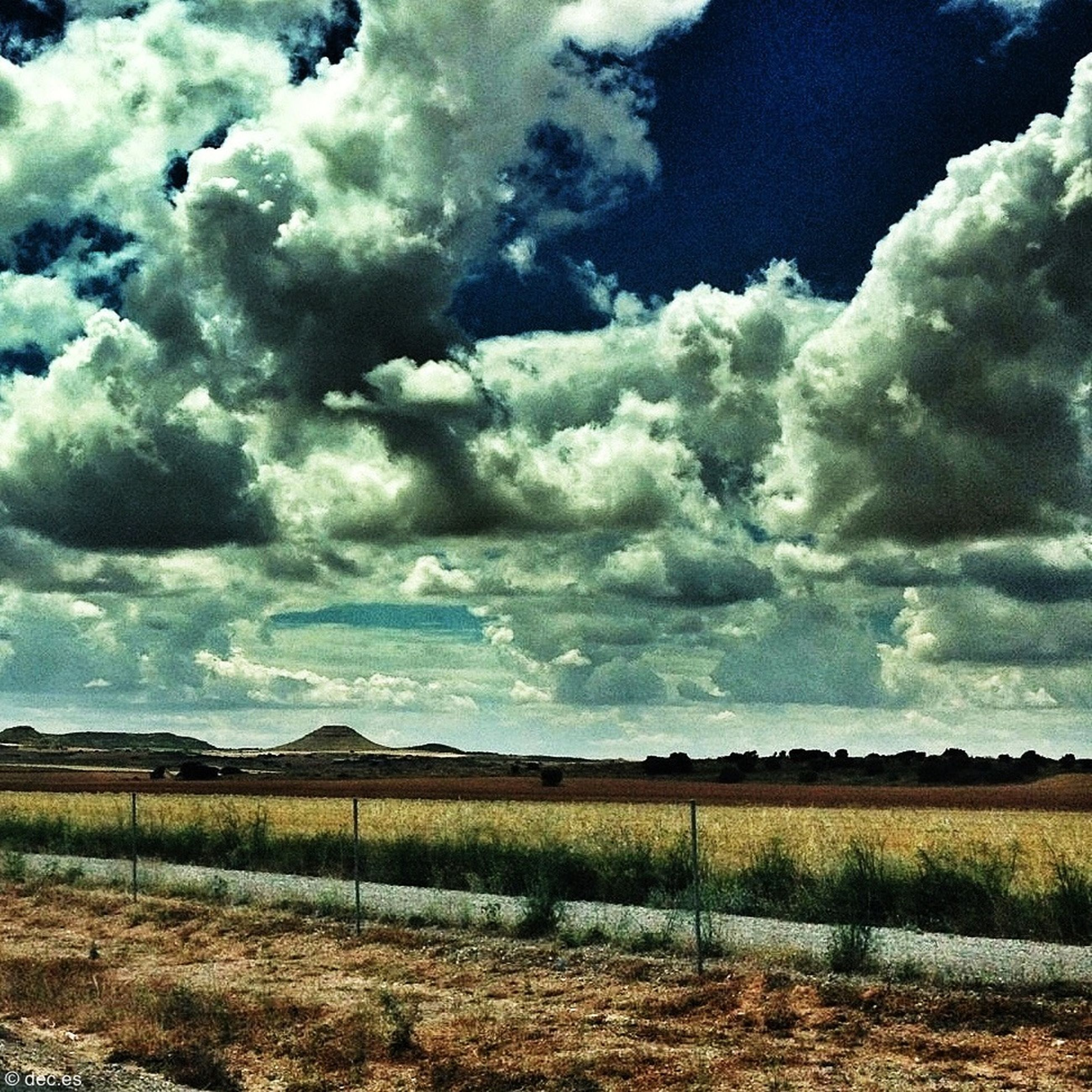 sky, cloud - sky, landscape, tranquil scene, cloudy, field, tranquility, scenics, grass, beauty in nature, cloud, nature, rural scene, weather, non-urban scene, idyllic, grassy, horizon over land, remote, outdoors