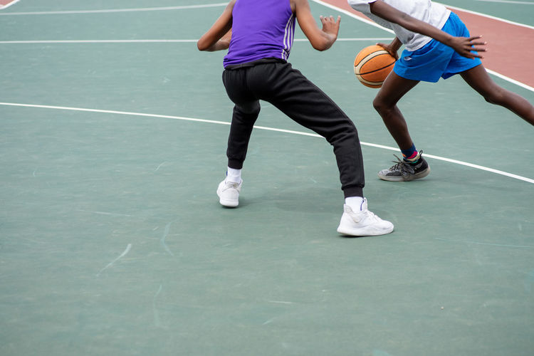 Low section of people playing basketball