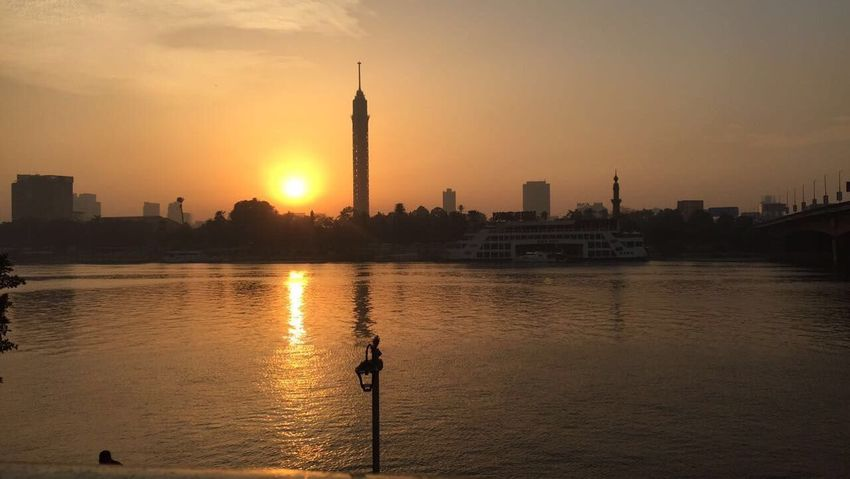 Beauty In Nature Nature Nofilter Cairo Egypt Cairo Tower Sunset Silhouettes Sunset_collection Sunset Nile Sunset Nile & Sky Nile River Sunset City Architecture Built Structure Building Exterior Skyscraper Water Travel Destinations Tall - High Tower Orange Color City Life River Sky Tourism Sun Travel Silhouette Cityscape An Eye For Travel