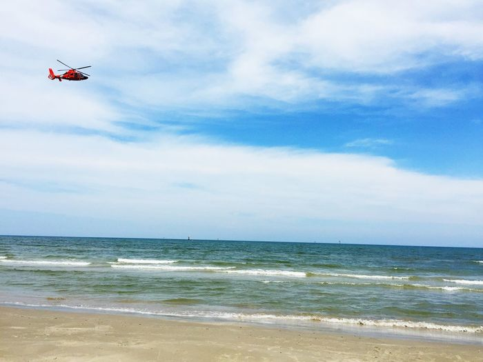Coast Guard Helicopter Beach Rescue Ocean View Clouds And Sky