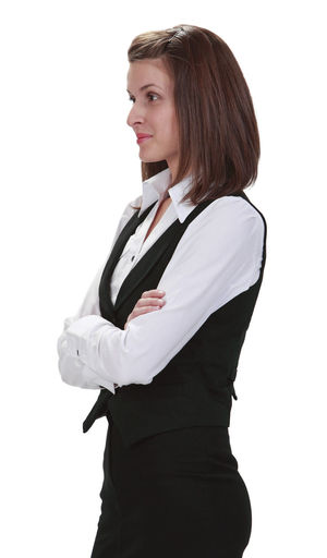 Young woman with arms crossed against a white background. White Background One Person Standing Portrait Cut Out Studio Shot Side View Young Woman Businesswoman Business Person Arms Crossed Young Adult Woman Young Cut Out On White Young Adult Waist Up Casual Clothing Three Quarter Length Profile View