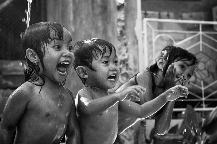 Siblings enjoying in water