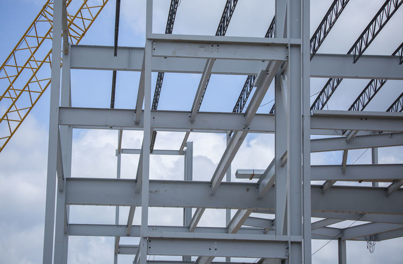 Low angle view of metallic structure against sky