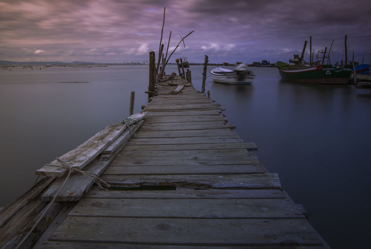 Cloud - Sky Diminishing Perspective Direction Jetty Mode Of Transportation Nature Nautical Vessel No People Outdoors Pier Sailboat Scenics - Nature Sea Sky The Way Forward Tranquil Scene Tranquility Transportation Water Wood - Material Wood Paneling