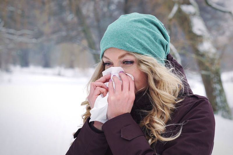 Cold Chill Flu Sick Blowing Wiping Nose Tissue Woman Real People Outside Winter