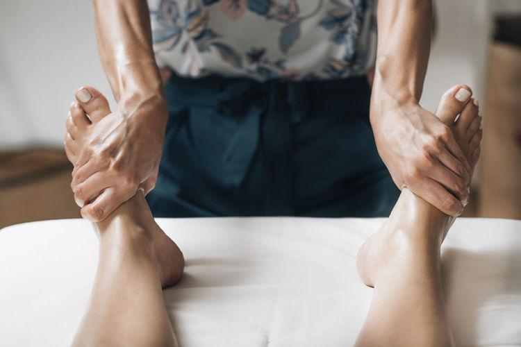 Ayurvedic reflexology foot massage with essential oil