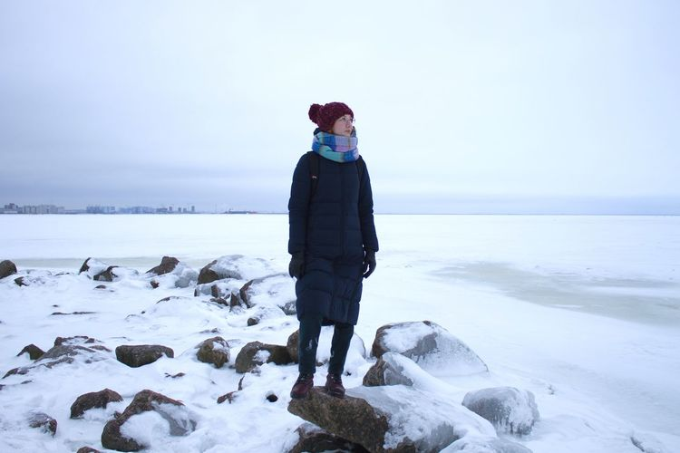 Rock - Object Bay Ice Seaside Woman Portrait Warm Clothing Full Length Cold Temperature Sea Winter Snow Standing Beach Blue Glacier Glacial Polar Climate Arctic Frozen Water Frozen