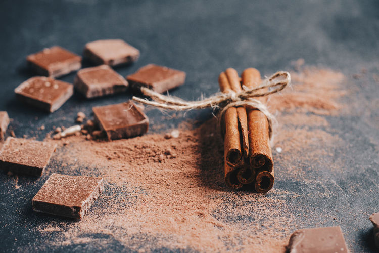 Close-up of chocolate and cinnamon on table