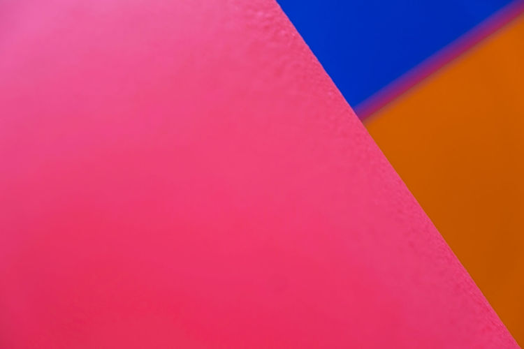 Abstract geometric pattern on concrete wall Backgrounds Blue Close-up Copy Space Day Full Frame Indoors  Low Angle View Multi Colored Nature No People Orange Color Paper Pattern Pink Color Red Still Life Textured  Wall - Building Feature