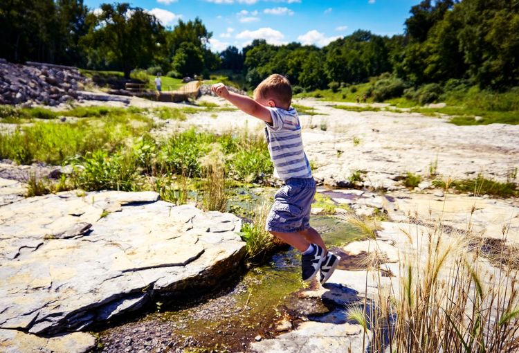 Discovery Youth Believe Hope Faith Making The Leap Progress Leap Jump Jumping Childhood Full Length Rock - Object One Person Casual Clothing Day Blond Hair Freedom Adventure Discovery Child People Real People One Boy Only Children Only Outdoors Boys