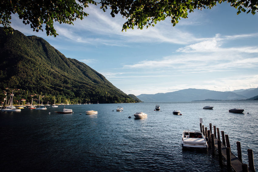 Harbor Harbour Romantic Beauty In Nature Boat Cloud - Sky Day Lake Moored Mountain Mountain Range Nature Nautical Vessel No People Outdoors Pontoon Scenics Sea Sky Tranquil Scene Tranquility Transportation Tree Water Travel Destinations