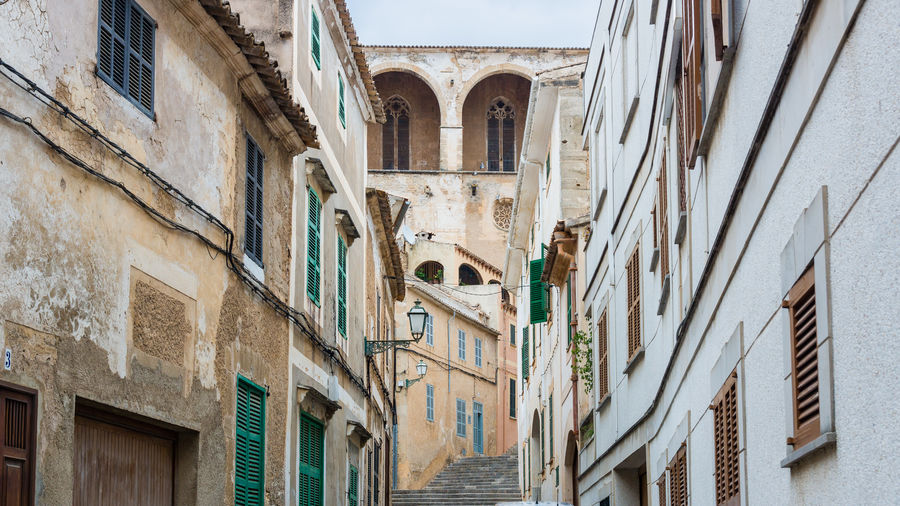 Arch Architecture Artà Balcony Building Building Exterior Built Structure City Day Exterior Façade House Low Angle View Mallorca No People Old Outdoors Residential Building Residential Structure Sky Sunlight Window