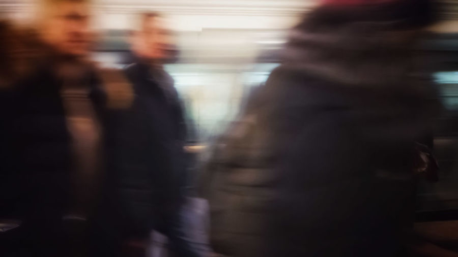 Blurred motion of people waiting at train