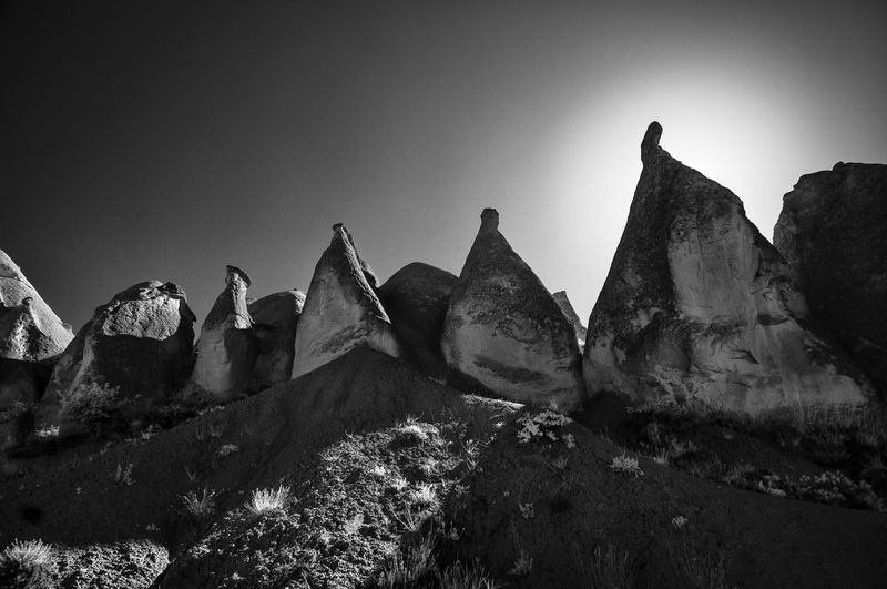 Low angle view of rock formations against sky at cappadocia