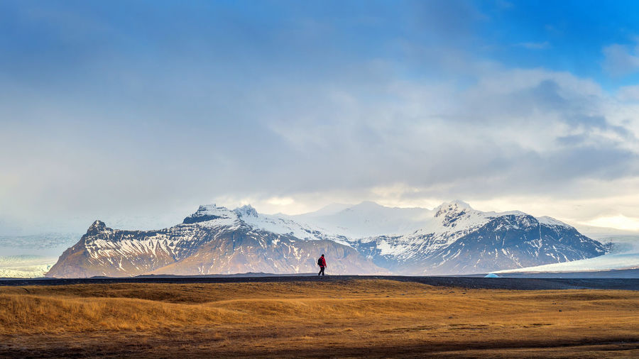 Beautiful landscape in Iceland. Beauty In Nature Cloud - Sky Cold Temperature Day Environment Land Landscape Mountain Mountain Range Nature Non-urban Scene One Person Outdoors Scenics - Nature Sky Snow Snowcapped Mountain Tranquil Scene Tranquility Water Winter