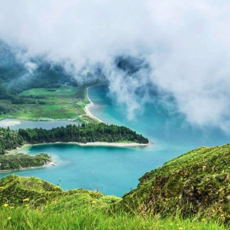 Lagoa do Fogo - a crater lake in Azores / Beauty In Nature Nature Scenics Water Outdoors Day Green Color Tranquility Tranquil Scene No People Motion Sky Azores Azores Islands Lagoa Do Fogo Travel Destinations Traveling Azores Beauty Lagoadofogo Misty Crater Lake Crater Mistery
