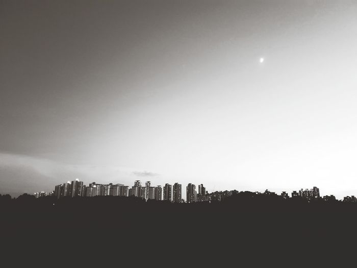 EyeEm Best Shots Countryside City View  Rear View EyeEmNewHere Beautiful View Moody Sky Dramatic Sky Blackandwhite City Illuminated Silhouette Moon Sky Office Building Planetary Moon Cityscape Half Moon Skyline